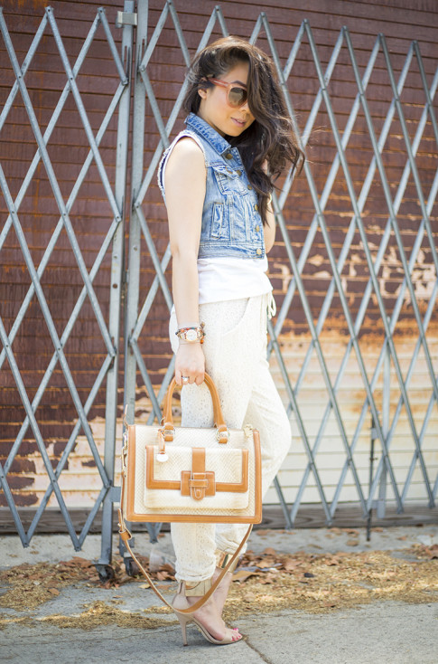An Dyer wearing Piper Gore Clementine Lace Pant, Celine Paris Audrey Pink, Bebe Jacqueline Sandals, Brahmin Atelier Brookline Satchel, Forever 21 Distressed Denim Vest, La Mer Collection Watch
