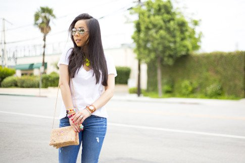 An Dyer wearing Rich & Skinny Clinton Jeans, Sole Society Oversized Turquoise Ring, ShopLately Glint & Gleam Neon Necklace & multicolor Cork Clutch, Kim & Zozi Bracelets, La mer Collections Watch, Mirrored Sun