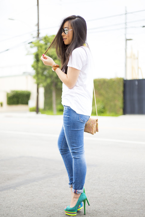 An Dyer wearing ShoeDazzle Jaleen Green, Rich & Skinny Clinton Ankle Peg Jeans,  La mer Collections Watch, Mirrored Sunglasses, Michael Stars White Tee, Multicolor Cork Clutch
