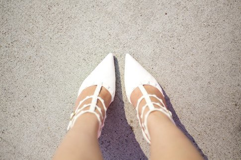 An Dyer wearing ShoeDazzle White Sahara Studded Pumps