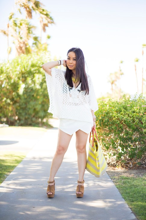 An Dyer wearing Sole Society Keeva Tote, Daniella Wedges and Citrine OVERSIZED FLORAL NECKLACE, LIV los angeles crochette caftan, Zara White Skort