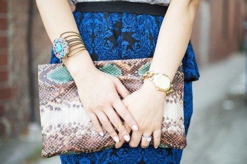 An Dyer wearing Dazzling Blue Torn by Ronny Kobo Sasha Skirt in New Baroque, Express Multi-function Chain Link Bracelet Watch, Zara Snake Print Clutch, Samanta Wills April Fifteen Cobalt Cuff