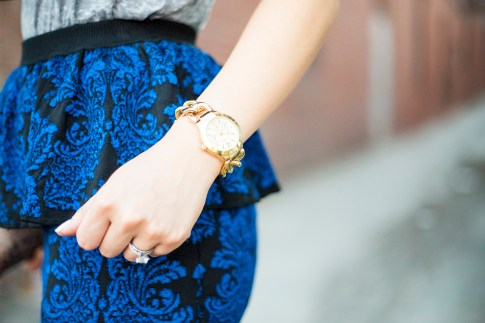 An Dyer wearing Torn by Ronny Kobo Sasha Skirt in New Baroque & Express Multi-function Chain Link Bracelet Watch