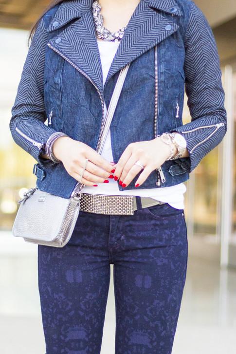 An Dyer wearing Levi's Combined Moto Jacket Chevron Denim, Revel Demi Skinny Purple Print, Cole Haan Village Crossbody Silver, Silver handcuff bracelet, Swarovski Slake Bracelet, Silver Bar two finger ring