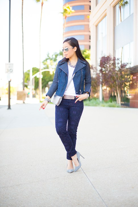 An Dyer wearing ShoeMint Bess Grey Suede Pumps, Levi's Combined Moto Jacket Chevron Denim, Revel Demi Skinny Purple Print, Silver Mirrored Sunglasses, Cole Haan Village Crossbody Silver, Silver Rhinestone Belt