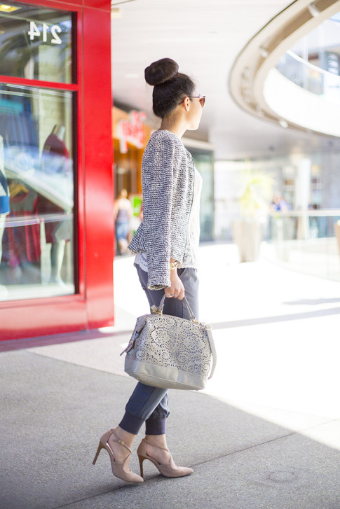 An Dyer wearing Sole Society Karenza Pumps in Nude Suede & Camille Laser Cut Satchel, LOFT Peplum Tweed Jacket, Michael Stars Tencel Banded Bottom Pant