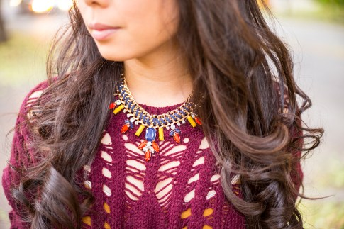 An Dyer wearing heartLoom Samara Knitted Sweater in Burgundy & Prima Donna Cosmopolitan Suede Braided Chain Necklace