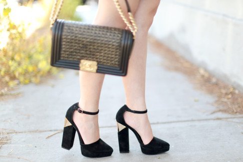 An Dyer wearing Chanel 14P Reverso Braided Boy bag GHW