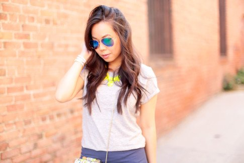An Dyer wearing Foster Grant Blue Mirrored Aviator Sunglasses, Neon Yellow Necklace and The One by Cotton On Tee