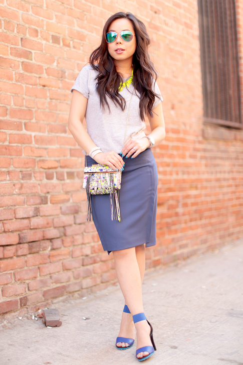 An Dyer wearing Foster Grant Blue Mirrored Aviator Sunglasses, Neon Yellow Necklace and The One by Cotton On Tee, Katherine Kwei Fringe Crossbody, Chaiken Skirt, ShoeDazzle Kaleen Blue Sandals