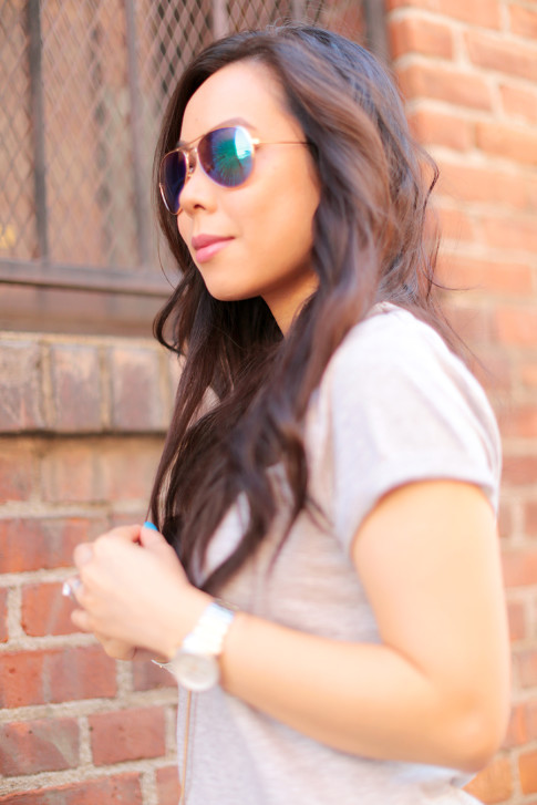 An Dyer wearing Foster Grant Blue Mirrored Aviator Sunglasses and The One by Cotton On Tee
