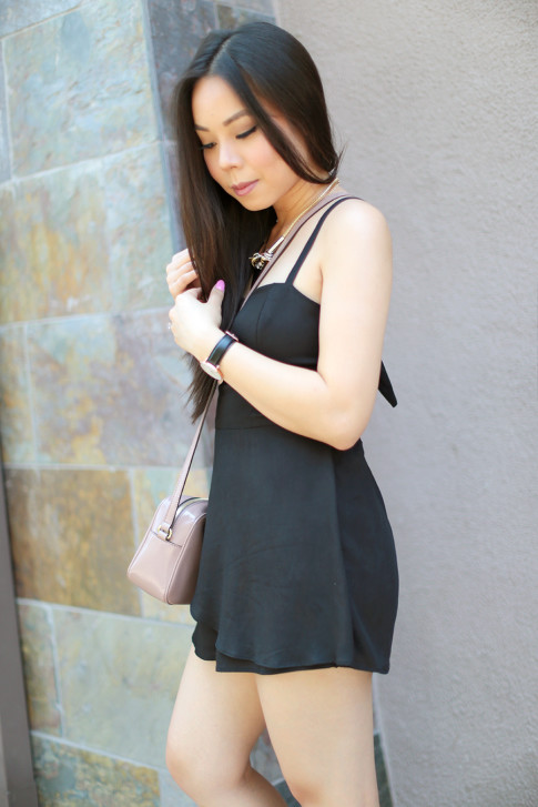 An Dyer wearing Della Urban Outfitters Black Romper