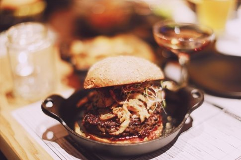 K-BBQ Burger - grilled pork belly with kimcheese, sprouting onion, gochujang bbq sauce,  sesame salt & fried onions... another exclusive dish to this location!