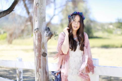 An Dyer wearing Coachella Street Style, LSpace Crochet Dress with Pink Fringe Kimono Purple Blue Flower Crown Kooba