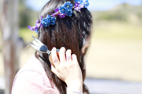An Dyer wearing Dogeared Balance Rings with Haus of Moo Dreamcatcher Ring, Flower Crown and LSTN Headphones