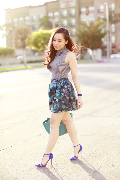 An Dyer wearing sleeveless turtleneck, express blue floral skirt with Gucci Swing Tote in Turquoise
