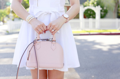 An Dyer carrying Louis Vuitton Alma BB in Magnolia, Hermes Hapi 3mm, Cluse Pink Watch