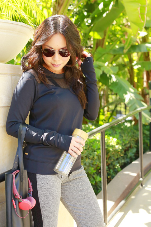 An Dyer wearing ALALA NEOPRENE SWEATSHIRT with MADE Eyewear