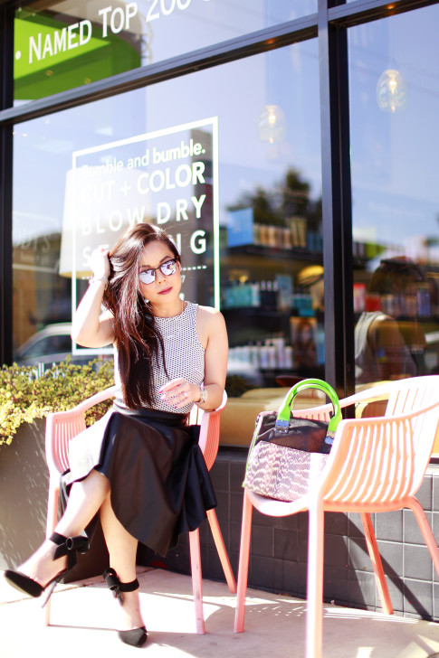 An Dyer wearing Black Leather Midi Skirt and Westward Leaning Sunglasses