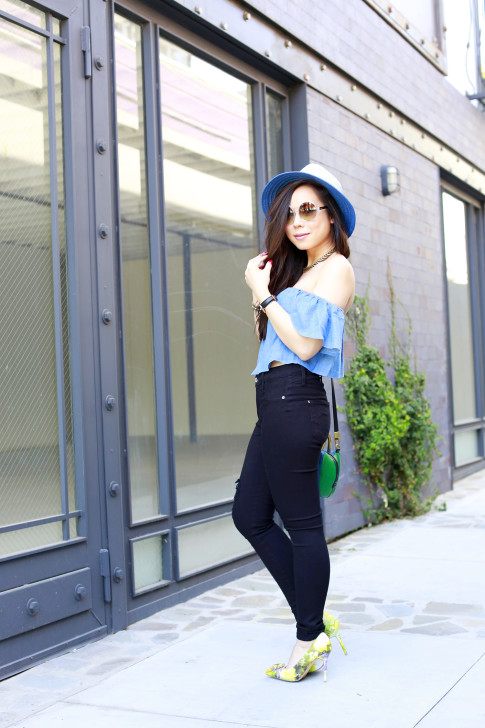 An Dyer wearing Blue Fedora with Guess denim off the shoulder top and black distressed skinny jeans
