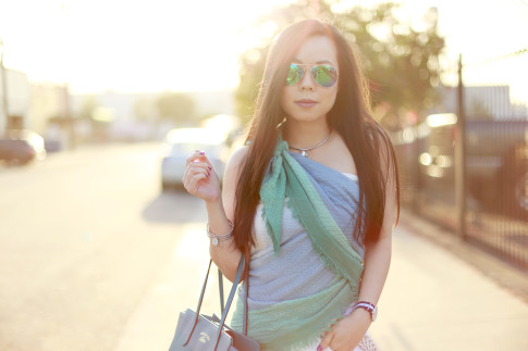 An Dyer wearing Express Ombre Scarf tied as a top shirt with Foster Grant blue green Mirrored Aviators