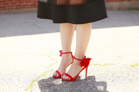 An Dyer wearing JustFab Red Rose Sandals