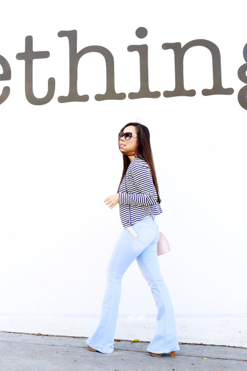 An Dyer wearing JustFab Striped Jacket with Bell Bottom Flared Light Blue Jeans