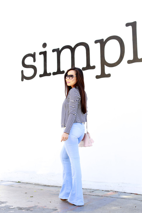 An Dyer wearing JustFab Striped Jacket with Bell Bottom Flared Light Blue YMI Jeans