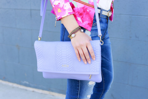 An Dyer wearing 7FAM jeans with Loren Hope Bracelets and gigi New York Carly Clutch Lavender