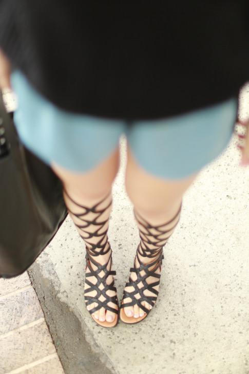 An Dyer wearing Black Knee High Gladiator Sandals