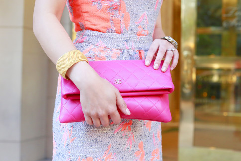 An Dyer wearing Chanel Pink Fucshia Foldover Clutch