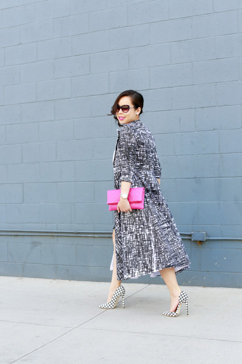 An Dyer wearing Chanel Pink QUilted Clutch with Doku AME'YO MARBLE LONG COAT, and JustFab Windowpane Pumps