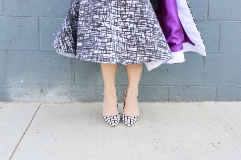 An Dyer wearing JustFab Windowpane Pumps