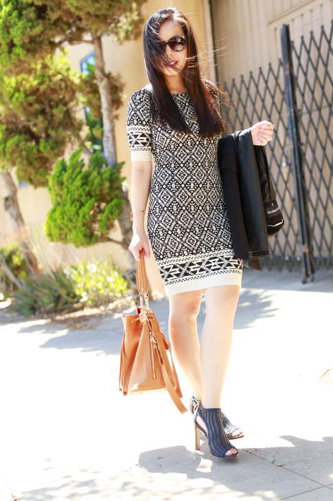 An Dyer wearing Karen Kane dress with Louise et Cie Sheree Woven Leather Sandals