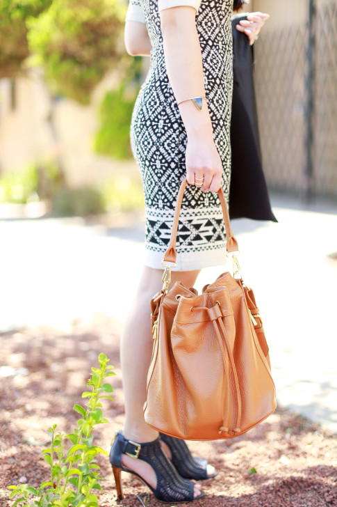An Dyer wearing Lena Bernard Cuff with Ora Delphine Bucket Bag