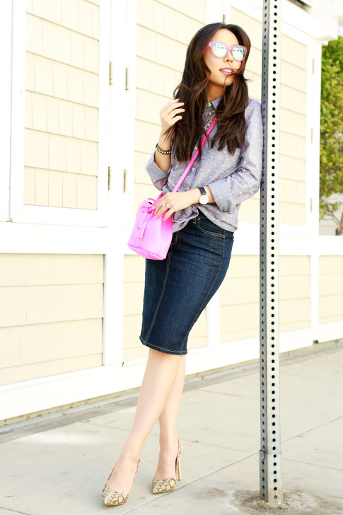 An Dyer wearing TOMS Travelers Pink Mirror Sunglasses, Splendid Shoreside Dot Shirt, CJ By Cookie Johnson Denim Skirt, Schaffer LA Pink Mini Bucket Bag