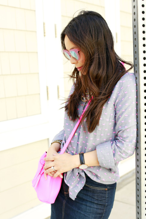 An Dyer wearing TOMS Travelers Pink Mirror Sunglasses, Splendid Shoreside Dot Shirt, Schaffer LA Pink Mini Bucket Bag