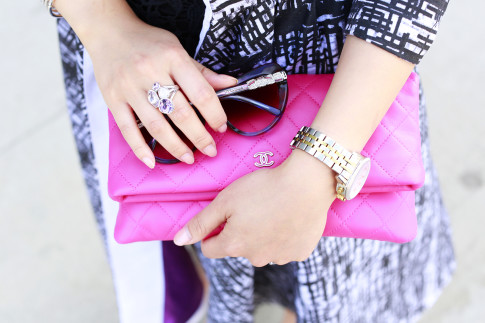 An Dyer wearing Tacori Ring, Bulgari Sunglasses with Chanel O Case Foldover Clutch Fuschia Pink