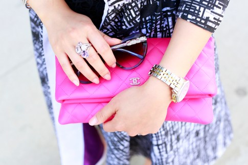 An Dyer wearing Tacori Ring, Bulgari Sunglasses with Chanel O Case Foldover Clutch Fuschia Pink