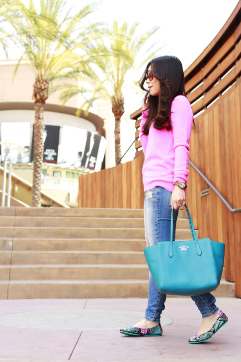 An Dyer wearing White Warren Hot Pink Cashmere Sweater with Hart Denim jeans, Gucci Swing Tote and Tieks