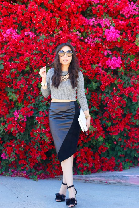 An Dyer Bougainvillea wearing Khalo BLACK LEATHER BLACK SUEDE ANGULAR SPLIT SKIRT with Crop Top and fur bow sandals toe