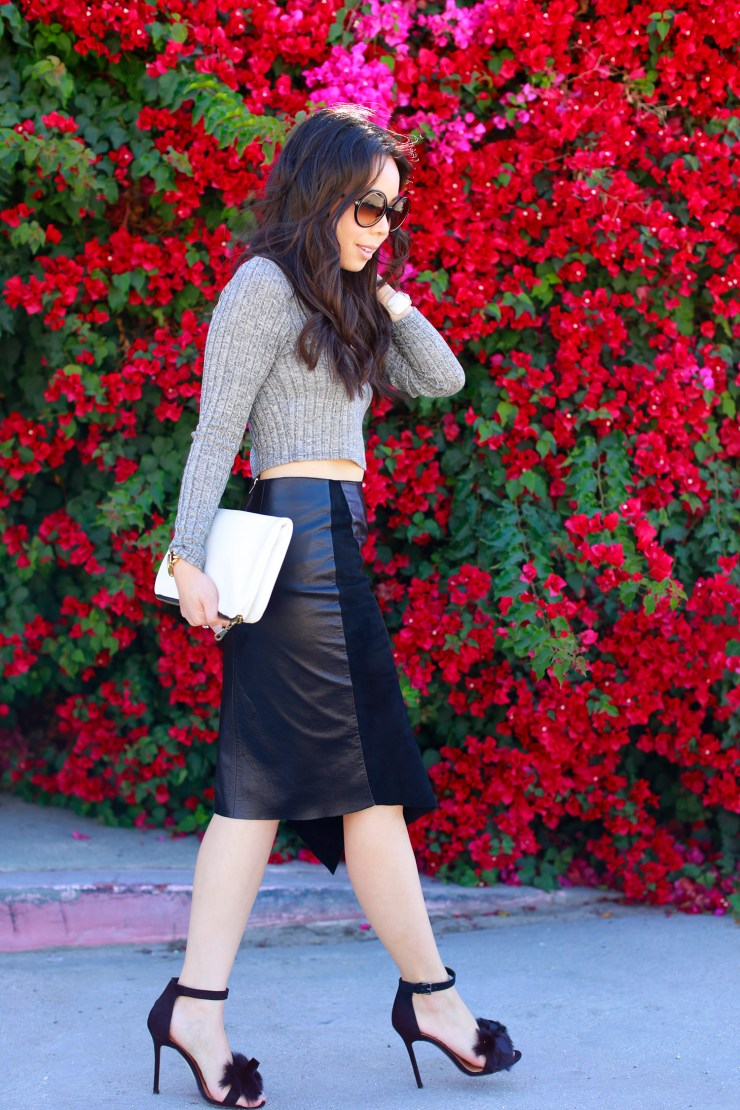An Dyer Bougainvillea wearing Khalo BLACK LEATHER BLACK SUEDE ANGULAR SPLIT SKIRT with fur bow sandals toe