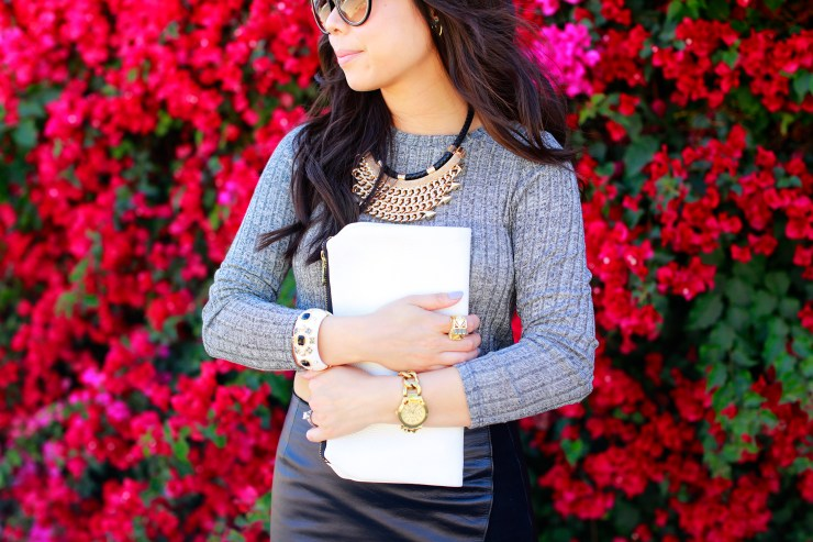 An Dyer wearing Passiana Necklace with Tom Ford Carrie Sunglasses and Isharya Ring and Express Watch