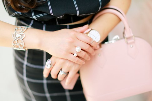 An Dyer wearing Bling Jewelry Formal Elegant Cuff with Tacori Purple Ring and Wunderlust Co Pearl Ring Louis Vuitton Alma BB Magnolia