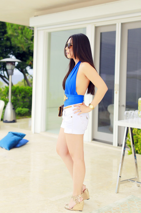 An Dyer wearing Forever Unique Cobalt Blue Bikini, True Religion Shorts, Klub Nico Wedges