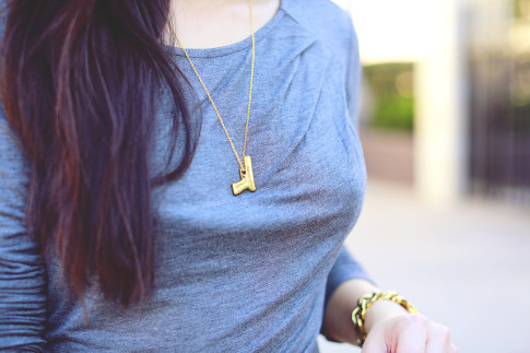 An Dyer wearing Vera Meat Gold Gun Pistol Necklace