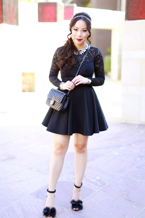 An Dyer wearing Bebe Black Lace Skater Dress with Fur Sandals and Chanel Like A Chevron Black Flap