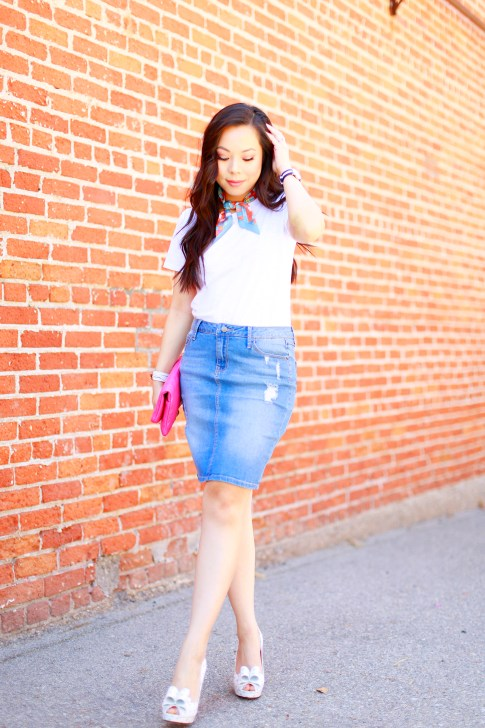 An Dyer wearing Hermes Twilly Neck Tie, Chanel Hot Pink Clutch, Denim Pencil Skirt, Palter Deliso Bow Pumps