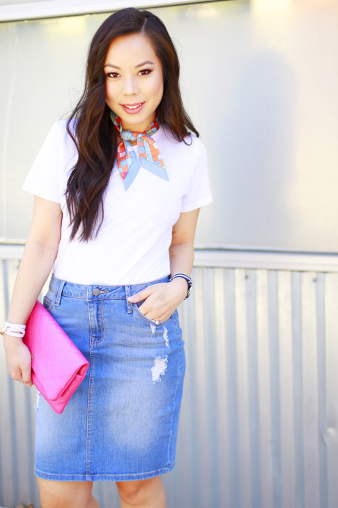 An Dyer wearing Hermes Twilly Neck Tie, Chanel Pink Foldover Clutch, Denim Pencil Skirt