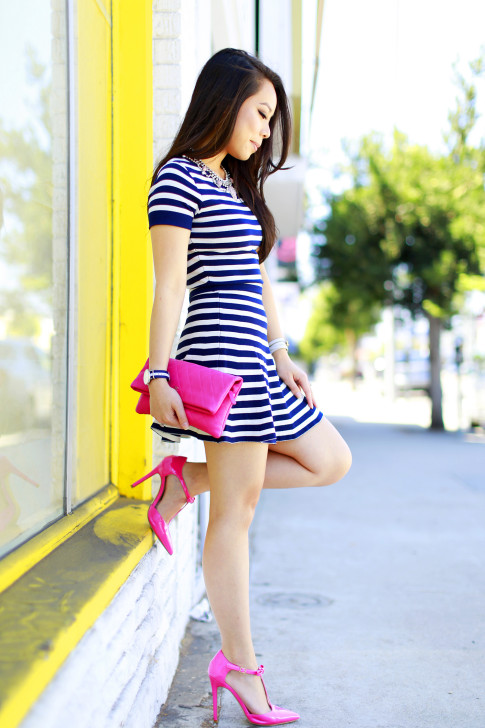 An Dyer wearing Lucy Paris Navy Striped Skirt Set with Hot Pink Chanel